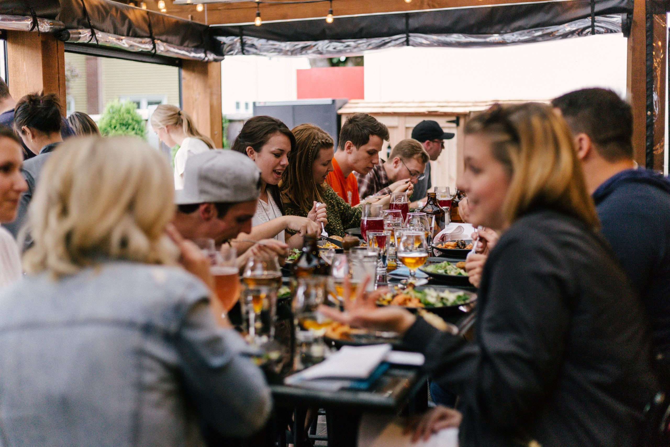 People eating a meal around a restaurant table of a restaurant with a 360 virtual tour